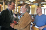 Michael Bennet (cq) greets Kevin Bradley (cq) of Freemont County  during a community gathering and...