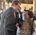 Michael Bennet (cq) greets Pueblo resident Dee Crill (cq)  during a community gathering and...