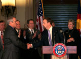 (104) Governor Bill Ritter shakes hands with John Brackney, president of the South Metro Chamber...