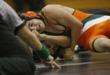 In Class 5A non-league wrestling in the 125 wt. Adams City Eagle's Felipe Marionez won...