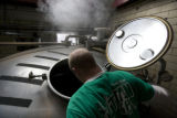 Taylor Rees checks on the mash at Great Divide Brewing Company in Denver, Colo. Wednesday, January...
