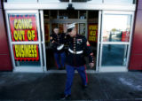 (CMS537) Marine recruiters Staff Sgt. James Prince, left, and Sgt. Ronal Avelar, right, look for...