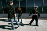 (CMS308) Marine recruiters Staff Sgt. James Prince, right, talks with potential recruit Samuel...