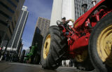 Antique tractors drive down 17th St. from Union Station in downtown Denver Tuesday January 13,...
