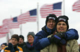 (1246) Sara Yeager, left and Cathy Weyers, right, both of AZ, keep each other warm as thousands of...