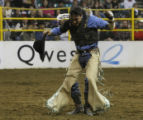 At the National Western Stock Show bare bronc rider Ryan Stutes does a little canjun shuffle after...