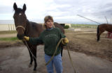 Paula Rodgers (cq Paula Rodgers) works with Miss Chinook, a three year-old thoroughbred,  at...
