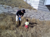 Brian Rothberg and daughter Sachi clean trash along Westerly Creek during the National Day of...