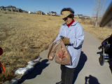 Inge Wieland cleans up at Westerly Creek during Natl Day of Service ..photos from cleanup location...