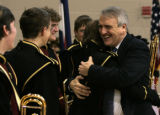 (0768) Governor Bill Ritter gives a hug to band member Vince Ramirez as the Windsor High School...