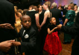 (0063) Jahlil Jefferson (cq), 8, left, dances with his mother Nicke Jefferson (not pictured) (cq)...