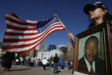 DM0089  MLK56477 Holding a photograph of Dr. Martin Luther King Jr., Maria Elena Alaniz, 60, of...