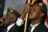 DM0780  A tear streams down the face of Kenneth Thomas, 49, as he posts the colors along with...