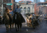 The annual stock show parade went underway, as cowboys herded their cattle up 17th St and Market...