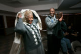 0300 Barbara and Kent Morgan celebrate as they join their church family to watch the inauguration...