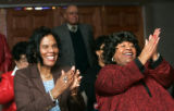 0195 Members of the New Life Church Gertrude Thames, left, and Carrie Carter Young celebrate as...