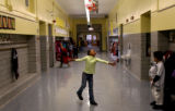(PG16556) Chalaya Davis (cq), 6, dances in the hallway of Ashley Elementary School at the end of...