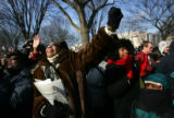 (1275) People in the crowd on the National Mall react after Barack Obama was sworn in as President...