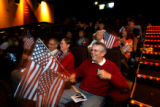 DM1455  MLK56477 Richard Strauss, 60, of Arvada, Colo. waves his flags as he watches the...