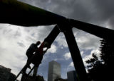 "Bill Coleman, 51, cq, of Denver, climbs a 14-foot ladder that makes the ""Bubble Tower""..."