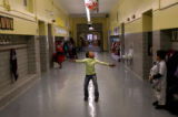 (PG16557) Chalaya Davis (cq), 6, dances in the hallway of Ashley Elementary School at the end of...