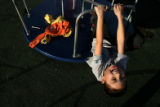 (PG14715) Juan Duran, 7, spins on the playground at Lincoln Park on Wednesday, January 21, 2009 in...