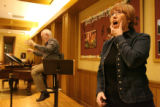 Mary Louise Burke coaches members of the Colorado Symphony Chorus during rehearsal Tuesday night,...