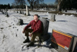 Max Donaldson, sits among grave sites at Fairmount Cemetery in Denver on January 14, 2009, with a...