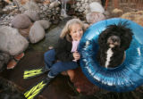 Lefty, a portuguese water dog, and owner, Martha Thomas, at a friend's home in Highlands Ranch. ...