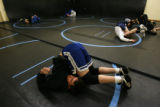 MJM537 Charlie Hartman (cq), 18, stretches during wrestling practice at Revere Jr. and Sr. High in...