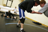 MJM641 Charlie Hartman (cq), 18, right center, wrestles, Corey Mikelson (cq), right, during...