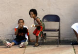 Brothers Deairis Garrett (cq left),9, and Ndaylay Garrett (cq right),4, spend Sunday after noon...