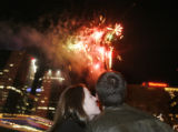 Jill Toelle (cq) kisses her new fiance, Bryan McMichael (cq) as they watch the fireworks show in...