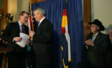 Major players Michael Bennet, and Gov. Bill Ritter and Sen. Ken Salazar stand at the podium at the...