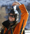Jesse Hall, from Boulder, Colorado, smiles as he turns off his head cam after jumping off a ski...