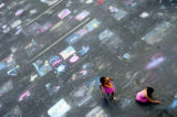 Four-year-old Mariana Hernandez (cq), right, and her sister 6-year-old Michelle Hernandez (cq),...