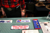 (PG7847) Pamphlets and bumper stickers are spread out at the Firearms Coalition of Colorado booth...