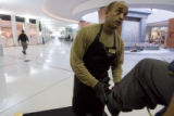 DM0010  Greg Perry shines shoes in the lobby of the Independence Plaza in Denver Tuesday Dec. 16,...