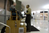 DM0011  Greg Perry shines shoes in the lobby of the Independence Plaza in Denver Tuesday Dec. 16,...