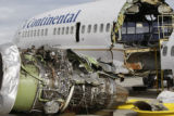 The wreckage of Continental Flight 1404 is placed in an enclosed area of Continental hangar in...