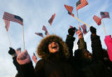 (0043) Nahkitta Hubbard (cq), left, and Nichelle Wilson (cq), right, wave American flags as they...