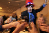Arty Smith from Elbert, (wearing hat) and a table full of friends toasts President Barack Obama at...
