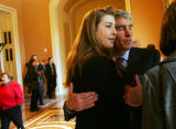 (0359) Newly-elected Colorado Senator Mark Udall hugs hi daughter Tess Udall after being sworn...