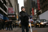 Actor Keean Johnson, 12, stands outside the Imperial Theatre, home of the Broadway musical Billy...