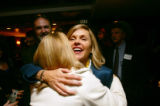 (0026) Newly-elected Congresswomen Betsy Markey hugs family friend Kathleen McBride at a party for...