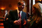 (0030) Newly-appointed Colorado Senator Michael Bennet talks with Elaine Thorndike at a party at...