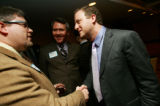 (0034) Newly-elected Congressman Jared Polis, left, shakes hands with Eric Peterson at a party for...
