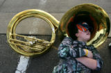 (1961) Austin Jardine, 15, rests his head in the bell of his sousaphone after Windsor High School...