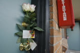 DM0458  Two white roses were left on the door of the apartment where 23-year-old Lauren Johnson...
