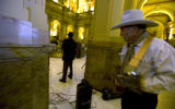 Rep. Wes McKinley (D- Wash) waits in the wings as fellow musician Bob Laughlin, 59 of Denver plays...